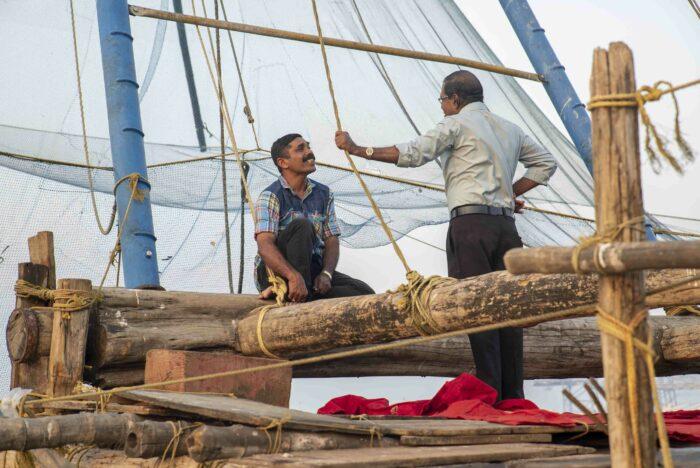 pescadores sonriendo como fotografía de viajes